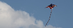 A patriotic kite flies high over the beach at Ocean City, N.J.