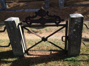 There were a number of these intricate iron gates in the cemetery.  Most of the ones I saw were along grassy paths with lines worn down by tires.  We came across a group tour on foot nearby.