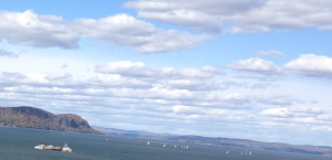 Hook Mountain and sailboats going past it along the Hudson River.