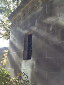 Beautiful sunbeams reach across the back of the mausoleum by The Bronze Lady.