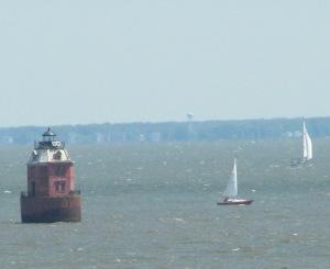 Lighthouse Sailboats